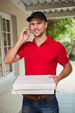 Happy pizza delivery man on the phone