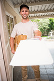 Happy delivery man showing clipboard to sign to customer
