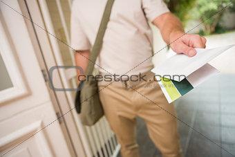 Postman delivering a letter