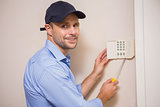 Handyman fixing an alarm system