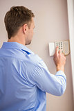 Man arming a home alarm