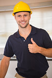 Smiling construction worker giving thumbs up
