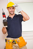 Construction worker posing while holding power tool