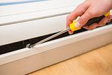 Handyman fixing an air conditioning