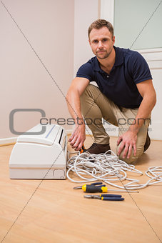 Focused handyman fixing air conditioning