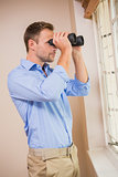 Man looking through a binoculars