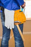 Rear view of handyman in tool belt
