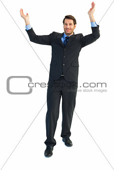 Businessman cheering with hands raised