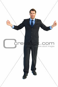 Smiling businessman holding something with his hands