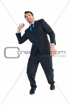 Businessman carrying something heavy with his hands