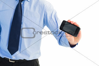 Close up of businessman holding a phone