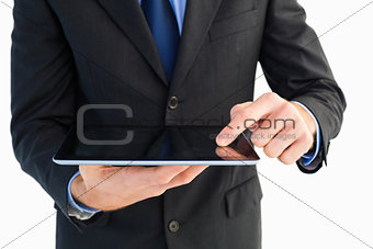 Close up of finger from businessman touching tablet