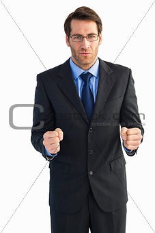 Angry businessman with closed fists looking at camera