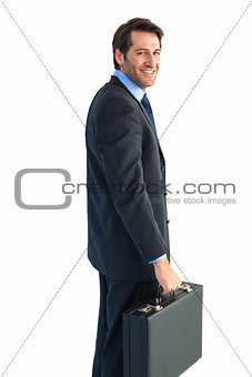 Smiling businessman holding a briefcase