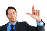 Confident businessman pointing at something