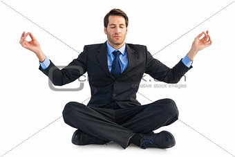 Calm businessman sitting in lotus pose
