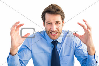 Annoyed businessman raising his hands