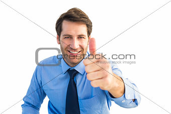 Smiling businessman gesturing thumbs up