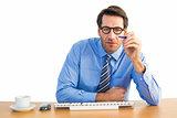 Focused businessman holding pen at desk