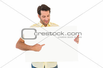 Attractive man smiling and pointing white poster