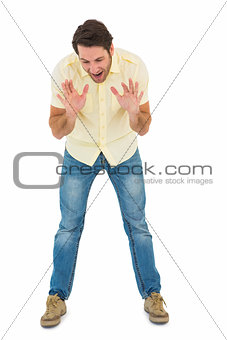 Angry man shouting at the floor