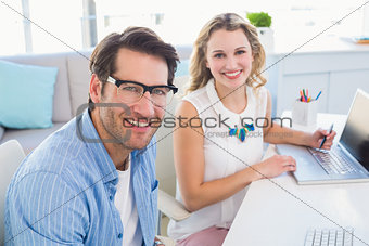 Portrait of two smiling creative business