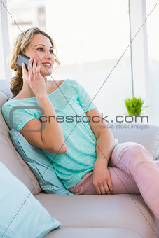 Blonde woman on the phone on the couch