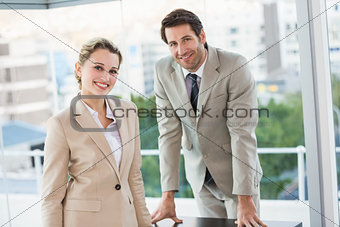 Business people posing and smiling at camera