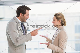 Angry man pointing at his colleague