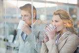 Business people drinking cup of coffee through the window