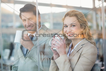 Business people holding cup of coffee through the window