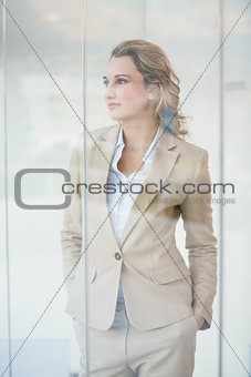 Portrait of thoughtful businesswoman through the window
