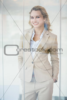 Portrait of smiling businesswoman through the window