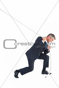 Classy businessman pulling a rope