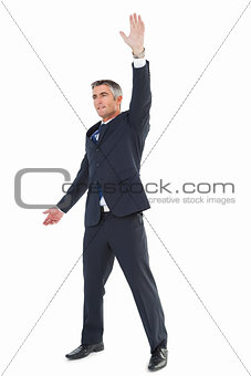 Smiling businessman doing a gesture
