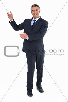 Smiling businessman in suit doing gesture