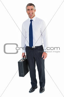 Smiling business man holding briefcase