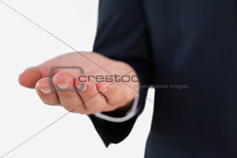 Close up of a businessman with hand out