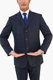 Mid section of a businessman in suit with hands out