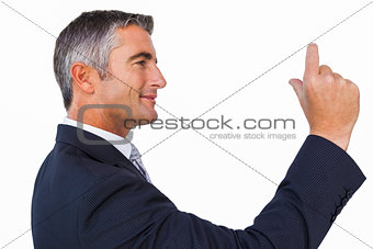Smiling businessman looking his hand