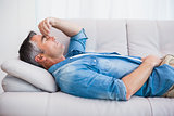 Man with grey hair relaxing on the couch