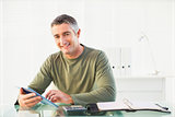 Smiling casual man using tablet pc