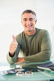 Positive casual man with his thumb up
