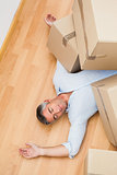 Man resting under his cardboard boxes