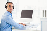 Man with headset using computer
