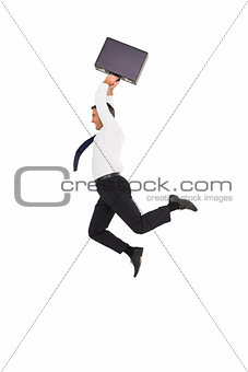 Smiling businessman leaping while briefcase
