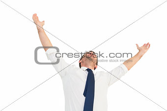 Handsome businessman cheering with arms up