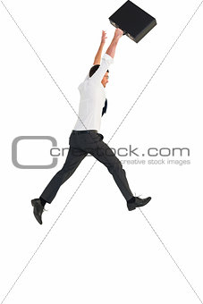 Businessman leaping with his briefcase