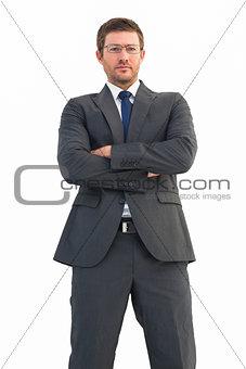 Frowning businessman looking at camera