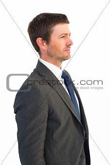 Handsome businessman looking away